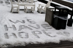 "Family House guests spell out ""We Have Hope"" in the snow"